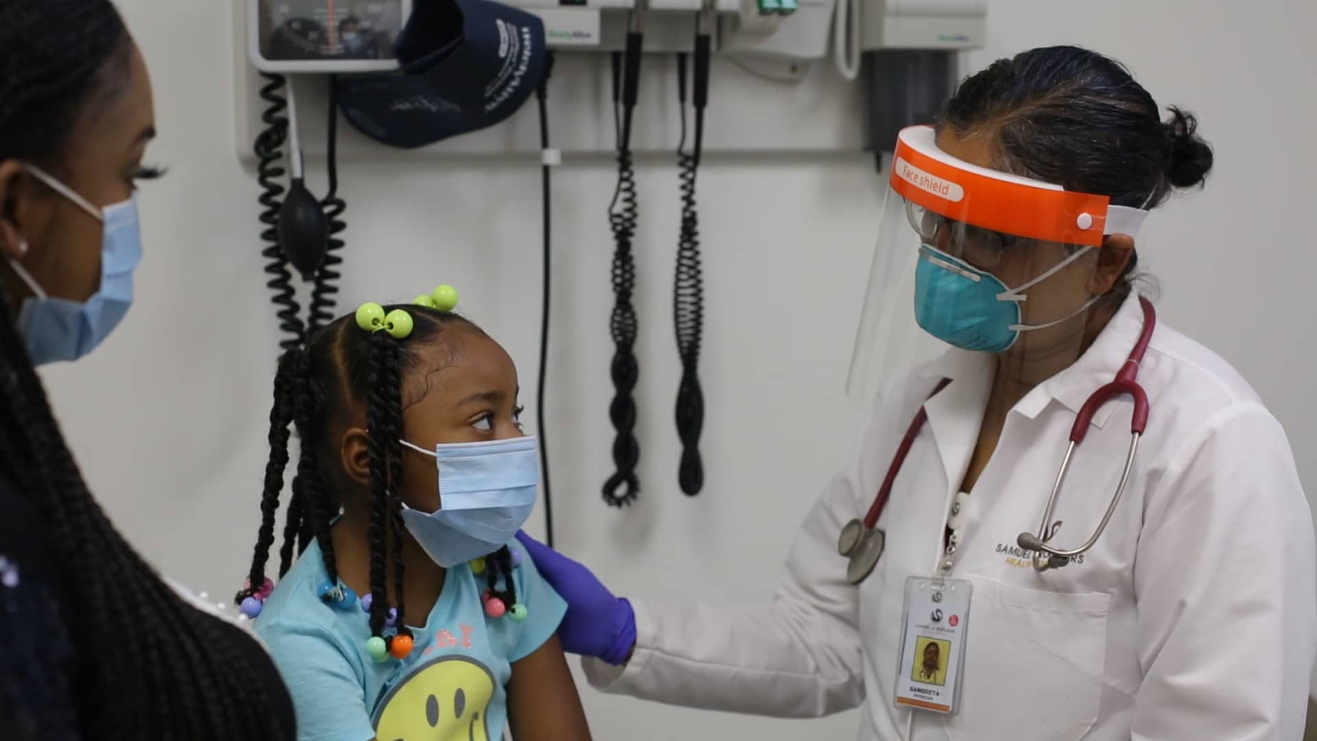 Photo of a young girl talking to a doctor.
