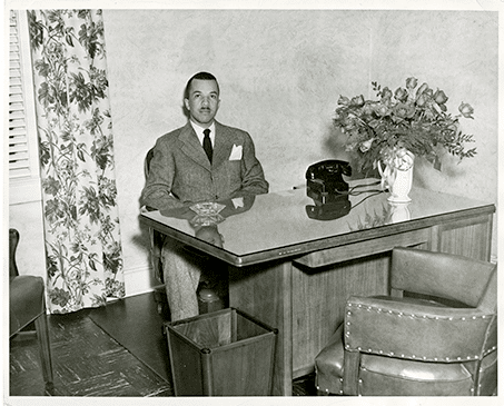 Young Dr. Rodgers at his desk