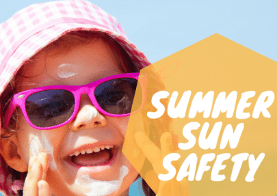 """Photo of a child putting on sunscreen labelled """"summer sun safety."""""""